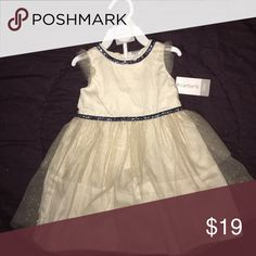 Carters baby party dress An off white dress trimmed in navy glitter and covered in sparkling gold tulle. Carter's Dresses Formal