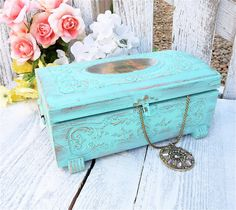 A very pretty soft aqua, shabby chic jewelry or trinket box. Made of cedar, this box will store all of your treasures, love letters, jewelry or