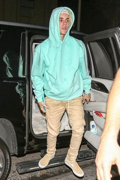Justin Bieber wearing  Vans Slip On Pro Skate Shoes, Fear of God The Drawstring Trousers, LMDN Distressed Tiffany Hoodie