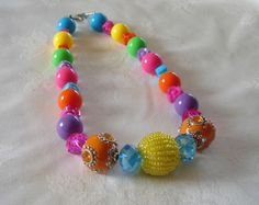 This bright bubble gum beaded necklace is sure to bring a smile to her face. It is approximately 17 inches long and closes with a toggle closure.