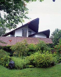 A request of the homeowner, this roof is made of curiously shaped thatched cogon. It gives the home a natural, outdoorsy, fairy-tale feel, complete with the birds that nest on the roof and the plants that grow.