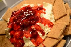 """""""Cherry Cheesecake Dip""""    Mix Jello No-Bake Cheesecake mix with one container of Cool Whip. Chill. Top with a can of cherry pie filling. Serve with graham crackers."""