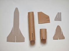 """Space Shuttle Craft (template included) Flying Cardboard Roll space shuttle craft that """"flies""""!Flying Cardboard Roll space shuttle craft that """"flies""""! Space Crafts, Craft Projects, Crafts For Kids, Arts And Crafts, Craft Space, Cardboard Rolls, Cardboard Crafts, Cardboard Rocket, Cardboard Playhouse"""
