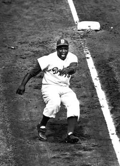 Jackie Robinson rounding Third base during World series against the Yankees, 1955