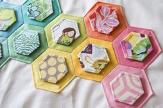 patterned hexies with solid border - Good idea for embellishment with hexagon punches.
