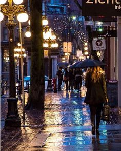 Gastown Nights ¸ Street lights reflect off the wet cobblestone on Water Street in Vancouver's Historic Gastown. A little bit of rain doesn't stop a true Vancouverite from exploring the city. Captured in Vancouver, British Columbia, Canada