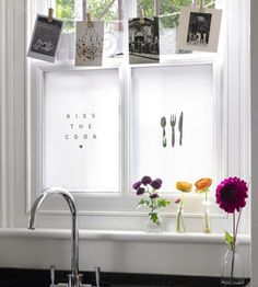 I love the charming look of these frosted windows strung with a line of photos and mementos.