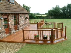 Timber decking and rail in front of house.