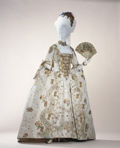 """Robe à la française with Matching Stomacher and Petticoat: ca. 1760, English, Spitalfields silk brocade, trimmed with metallic lace and gauze. """"...At Spitalfields in the East End of London, the silk industry was developed around 1700. During the mid-1800s, the high quality of Spitalfields' designs and fabrics rivalled the well-renowned textiles of Lyon, France. Queen Charlotte (1744–1818), wife of English King George III, willingly wore the dress of Spitalfields silk fabrics to encourage…"""