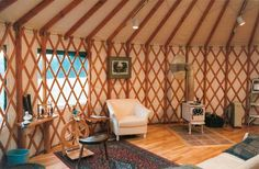 LOVE this! A yurt with  a gorgeous woodstove AND an awesome spinning wheel, when can I move in??