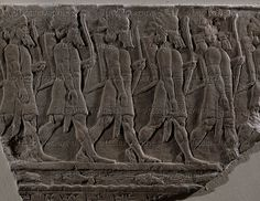 Elamite archers marching into battle. Stone bas-relief (7th BCE) from the palace of Ashurbanipal in Niniveh, Mesopotamia (Iraq).