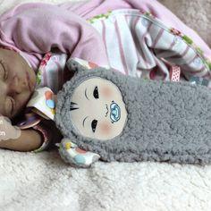 Tissu imprimé tête de poupée