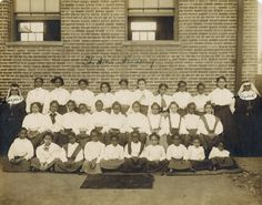 Sister Stephen & Sister Elizabeth with students @ St. Ann's Academy in 1910.