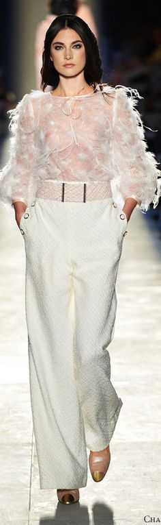 Chanel F/W 2012-2013  I don't know how feathers would work for the office, but I'm sure I'd figure something out.