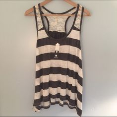 F21 Gray Striped Tank Top with White Lace NWOT Soft dark gray and white racerback tank top with white lace detail on the shoulders and upper back. In the front are faux buttons. Never worn, in perfect condition. Forever 21 Tops Tank Tops