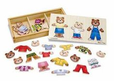 Melissa & Doug Wooden Bear Family Dress-Up Puzzle. This wooden set contains 45 mix-and-match pieces to assemble Mama, Papa and Baby Bear. The wooden box has compartments for easy storage and the box lid conveniently serves as a puzzle board. Wooden Puzzles, Wooden Boxes, Wooden Jigsaw, Toddler Toys, Kids Toys, Toddler Gifts, Baby Toys, Melissa & Doug, Dress Up Dolls