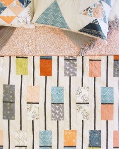 """Who agrees that the more quilts you have in your home, the cozier it is? We absolutely love adding quilts to our collection because they're handmade blankets of joy! . Add this lovely """"Totem"""" quilt made with #TapestryFabrics by @sharonhollanddesigns  to your collection with the pattern available in the look book (link in bio). . . #ArtGalleryFabrics #AGF #WeareFabrics #quiltlove #modernquilting #modernquilt #quilting #sewing #quiltsofinstagram #quiltdesign #FreeQuiltPattern #freepattern"""