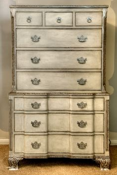 Segreto Secrets- gesso applied in a cream finish and highlighted with silver leaf detail transforms the stained wood of this dresser.