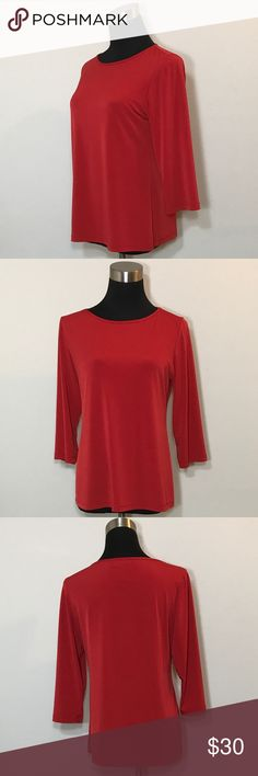 """Susan Graver Style Red Stretch Shirt QVC Size S Susan Graver Style Red Stretch Shirt QVC Size Small. Pre-owned, very gently used. This shirt looks new other than the size tag being faded. Slinky, stretch polyester (92%) and spandex (8%) blend. Solid red. 3/4 sleeve.  Bust 39"""" (99cm) Length 24"""" (61cm) Susan Graver Tops Blouses"""