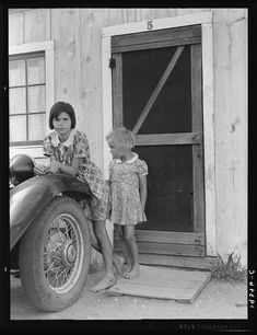 Greenfield, Salinas Valley, California. An Arkansawyers auto camp filled almost completely with migrants from Arkansas. Rent ten dollars a month for one room, iron bed, electricity. Rough board walls with cracks. This community is subject of a study by BAE Regional Office, Berkeley, California. 1939 Apr. Library of Congress.