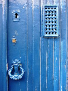 fresh blue paint by daniel virella@flickr.com  Old front doors from around the neighborhood. Lisbon, Portugal.
