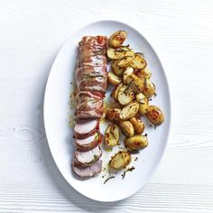 Parma-ham Wrapped Pork with Spiced Cornish New Potatoes, a delicious recipe from the new Cook with M&S app.