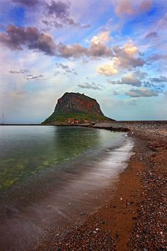 This is the area my family is from. It would be neat to see it one day... Monemvasia, Lakonia, Greece. photo by Hercules Milas
