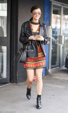 Pretty in patterns! Lucy Mecklenburgh, 25, showed off her slender legs in a patterned black, red and orange minidress while out and about in Essex on Saturday