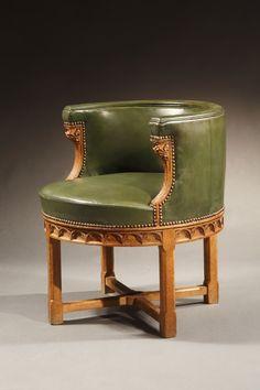 An English Oak Deskchair, Circa 1870 Height: 25 ½ inches (64.8 cm.) Diameter: 27 ¾ inches (70.5 cm.)