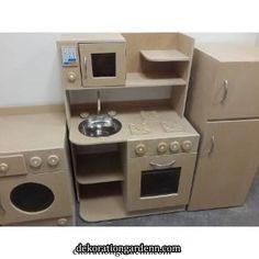 Have your kids been asking for a play kitchen set? Cardboard Kitchen, Diy Cardboard Furniture, Wooden Toy Kitchen, Diy Barbie Furniture, Cardboard Box Crafts, Cardboard Toys, Diy Kids Kitchen, Play Kitchen Sets, Diy Cozinha