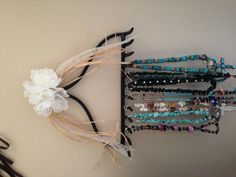 Repurposed rake turned into a country chic necklace holder!