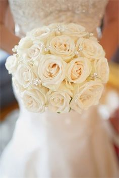 Ivory roses decorated with pearl beads for a glamorous and classy look, great for a Winter wedding.