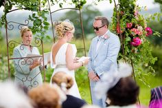 The bride reading the vows she had personally written. Matt and Alice's wedding blessing ceremony at their farm in Axminster, Devon. 27th June 2015. Ceremony designed and conducted by Diana Saxby www.gracetheday.com. Photos kindly supplied by Helen Cawte Photography www.helencawtephotography.com