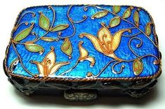 beautiful box covered in polymer with the look of enamel by Charlene Therien. From Polymmer Arts blog.