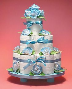 """TOILET PAPER CAKE ♦ Instructions in """"Toilet Paper Crafts for Holidays and Special Occasions"""" by Linda Wright. Cute gift or centerpiece for a bridal shower. Perfect accompaniment to a toilet paper wedding dress! Toilet Paper Cake, Toilet Paper Origami, Toilet Paper Roll Crafts, Wedding Towel Cakes, Wedding Shower Favors, Bridal Shower, Shower Party, Baby Shower, Funny Gifts For Women"""