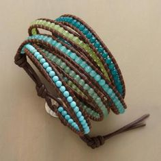 """Turquoise, aventurine, jade and quartz encircle the wrist five times in a blue green spectrum. Stones aligned between leather cords. Handcrafted by Chan Luu with sterling silver button clasp. 32"""" to 34""""L."""