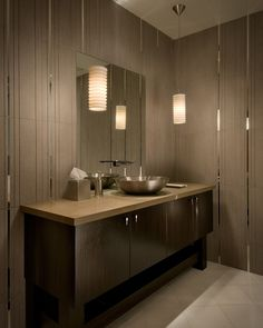 Very cool contemporary bathroom tile walls. Love the mirrored strips through the different sizes of tile.