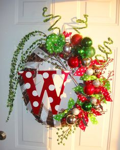 Add your favorite christmas decor to the wreath, add some ribbon and paint your inital to make the perfect wreath!!