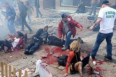 Wounded bomb victims lie sprawled amid a chilling, surreal scene in Boston.
