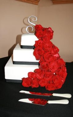 Color Combo: Black White Red.plus i really like the cake.simple with flowers
