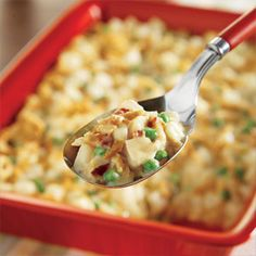 Stir the potatoes, 1 1/3 cups of the onions, peas, cheese and bacon in a 13 x 9-inch (3-quart) shallow baking dish. Stir the soup and milk in a medium bowl. Pour the soup mixture over the potato mixture. Cover.