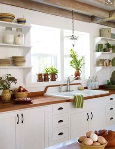 exposed beams, open shelving, love the countertop and counter colors but would want gold hardware