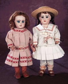 E. Douillet,for Emile Jumeau,circa 1890,the doll was a signature model for the long-time and trusted Jumeau worker,Emile-Michel Douillet,who had been mentored by Jumeau. Value Points: hard to find model with appealing expression,fine quality of bisque and painting,antique mariner costume.