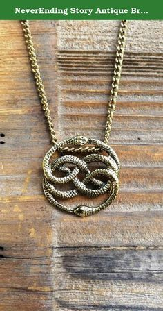 """NeverEnding Story Antique Bronze Necklace, Auryn Necklace, Long or Choker, Never Ending Story Snake Pendant, Snake Circle, Men's Necklace. Perfect for any NeverEnding Story lover in your life. Pendant is about 1 1/2"""" in diameter in antique bronze finish. Chain length options available, including choker lengths, and longer lengths (great for men)! Lobster claw clasp. Also available on a 20"""" black faux leather cord, lobster claw clasp. Comes in a sparkly gift box for easy gift giving."""