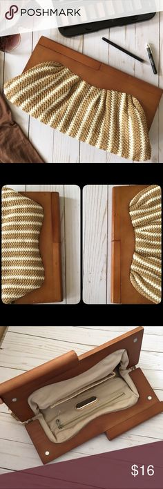 Wood & woven clutch Unique woven synthetic rattan type striped clutch with wooden top. One zip pocket & one open pocket inside perfectly clean fabric lining. Exterior fabric part of purses also in perfect condition. Wooden top of purse has some light scratches & some indentations & color variations, some of which are natural to the wood. Please see fourth picture for some mild nicks on one side of purse. Very lightweight and easy to carry. Urban Expressions Bags Clutches & Wristlets