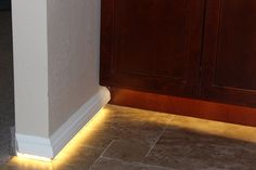 LED's everywhere. A creative idea for lighting underneath the baseboards. Mount baseboards on top of something to desired height, nail to wall. LED Strip lighting is just shy of a half inch wide so make sure baseboards are that thick. Place led stripping underneath board, apply power and connectors and now light the way!