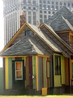 Colorful abandoned house near the train station by Detroit1701.