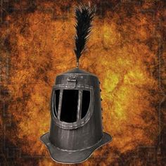 Sir Belvedere Helmets for sale is from the Monty Python and the Holy Grail movie. These officially licensed Monty Python and the Holy Grail movie helmets are crafted of lightweight fiberglass. The Sir Belvedere helmets are painted to resemble darkened, blued steel. They are manufactured in India and one size fits most. The Sir Belvedere Helmet has a functional, moveable visor. A real brass finial on the top of the helmet holds the included plume. Buy the Sir Belvedere Helmet.