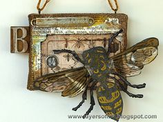 Layers of ink - Bee Burlap Panel Tutorial, with Tim Holtz papers, idea-ology embellishments, Sizzix dies and Wendy Vecchi Modeling Film. Burlap Art, Collage Techniques, Bee Cards, Steampunk Design, Insect Art, Bee Theme, Assemblage Art, Panel Art, Tim Holtz