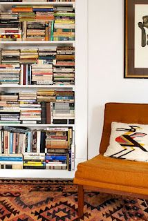 I love the book stacking arrangement for the tall shelves :) Tetris!